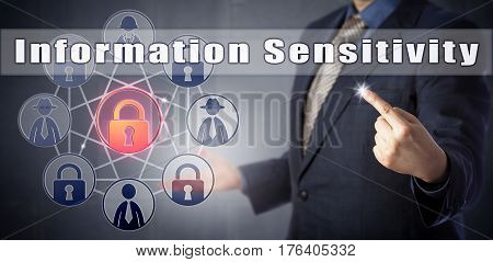Cyber security consultant in blue shirt and suit highlighting Information Sensitivity. Data security metaphor and information technology concept for commercial confidentiality trade secret privacy.
