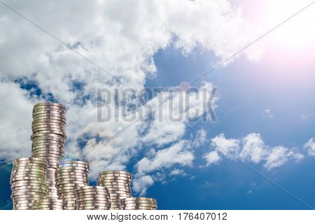 Columns Of Coins, Piles Of Coins Arranged As A Graph On Blue Sky Background