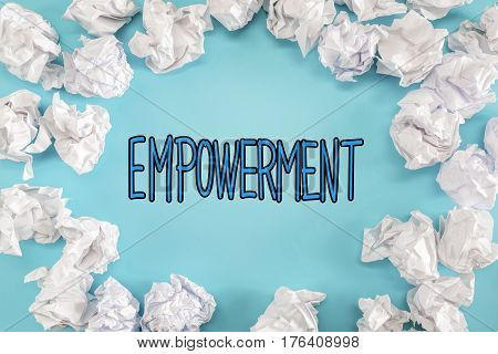 Empowerment Text With Crumpled Paper Balls