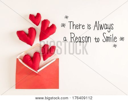 There Is Always A Reason To Smile Message With Red Heart Cushions