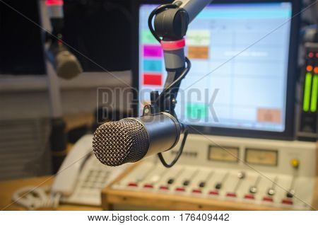 For radio stations: microphone and audio console in the studio