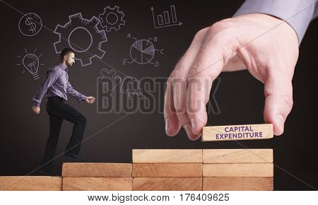 Business, Technology, Internet And Network Concept. Young Businessman Shows The Word: Capital Expend