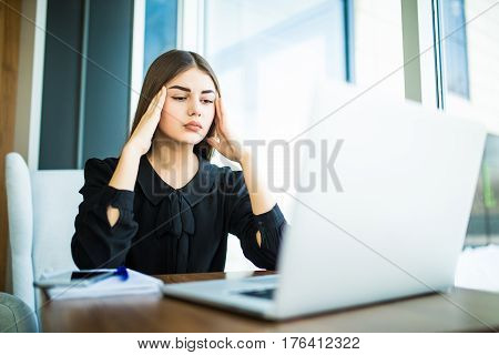 Tired Minded With Head Pain Woman Thinking About Way To Complete Task On Laptop At Table
