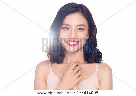 Glamour portrait of beautiful ASIAN woman model with nice makeup and romantic wavy hairstyle.