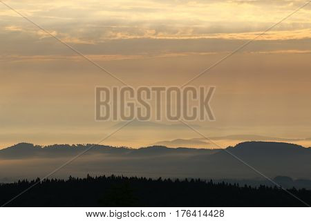 Sunrise in the mountains - hills in morning mist Giant Mountains Czech republic