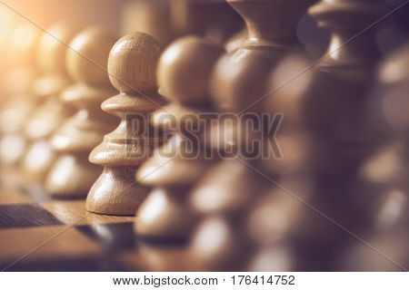 Close up of a wooden chess board and pieces. Selective focus