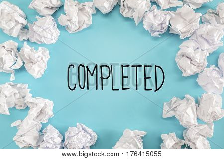 Completed Text With Crumpled Paper Balls