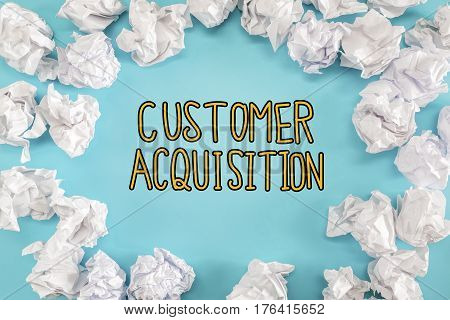 Customer Acquisition Text With Crumpled Paper Balls