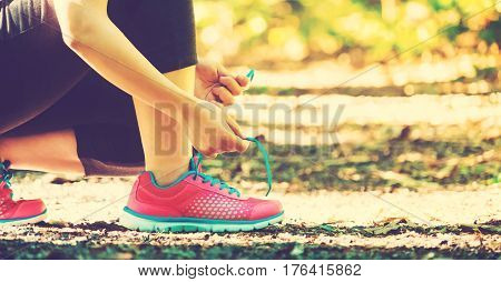 Female Runner Preparing To Jog