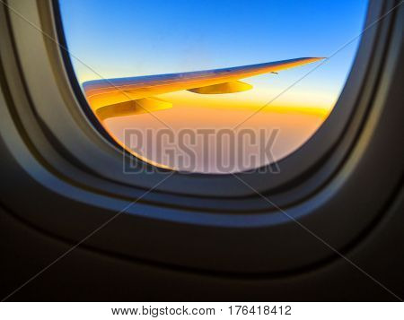 Beautiful sunset sky when see through the airplane window