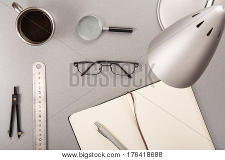 Collection of desk elements and a cup of coffee