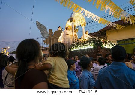 Leon Nicaragua - April 15 2014: People in a procession in the streets of the city of Leon in Nicaragua during the Easter celebrations
