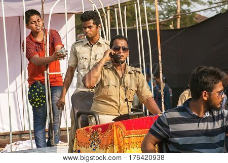 PANJIM, INDIA - FEB 25, 2017: Scene with actors in policemen uniform playing corruption police department at traditional Goa carnival on February 25, 2017. Carnaval is celebrated in Goa since 18th century