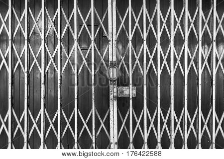 Old steel door texture pattern or steel door background with rusty metal. Grunge retro vintage of steel door for design. Black and white.