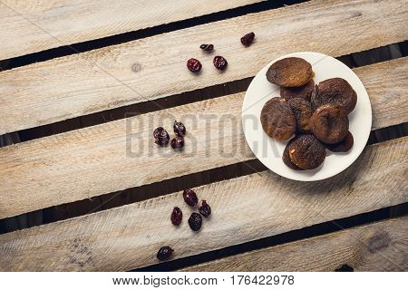 Dried Fruits On The White Plates