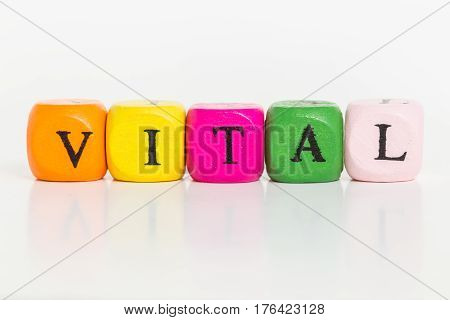 Vital letter cubes against white background picture