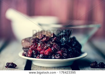 Dried Fruits On The White Plate
