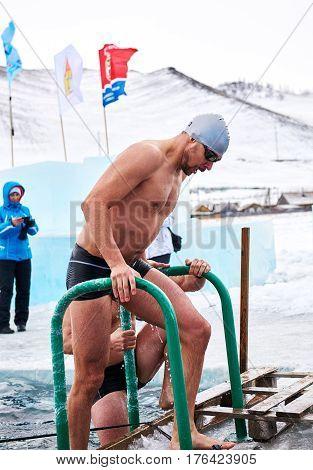 SAHYURTA IRKUTSK REGION RUSSIA - March 11.2017: Cup of Baikal. Winter Swimming Competitions. Swimmer after finish.