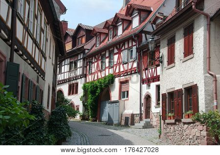 Old narrow street with half-timbered houses of the Gerberbach Quarter in Weinheim Germany