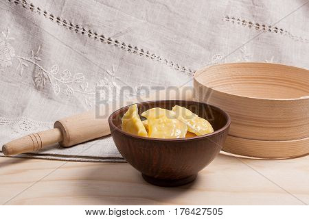 Fresh Boiled Varenyky Or Dumpling With Cottage Cheese Or Curd In Clay Bowl On Wooden Background.