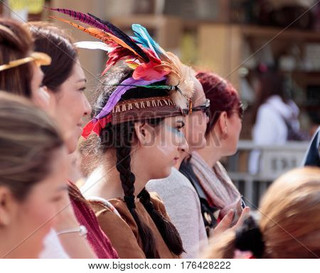 Girl Dressed In Indian Woman's Costume Looks At The Carnival