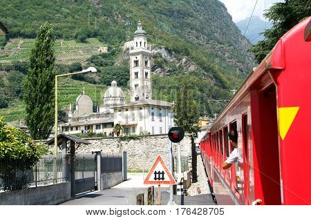 Bernina Express Train Arriving At Tirano On Italy