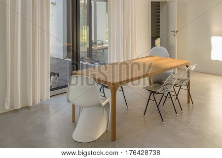 Dining Room Interior With Cat