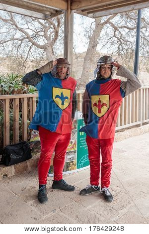 Caesarea Israel March 11 2017 : Employees of the national park in Caesarea dressed in the form of heralds of the Roman times stand at the entrance to the park during the Purim celebration in Caesarea Israel