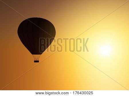 Silhouette of hot air balloon tourists watching sunrise