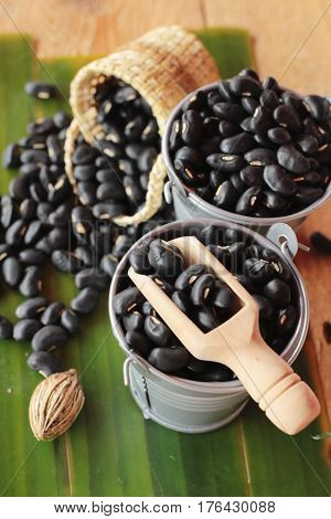 Black beans for health on wood background