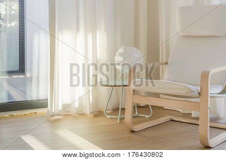 Interior With White Chair And Curtains