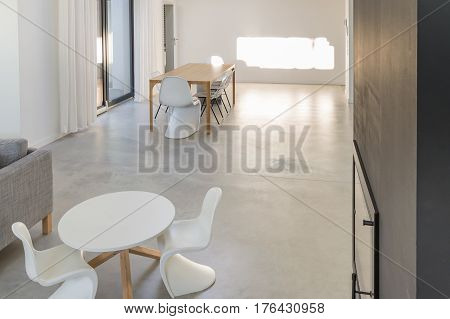 Room With Modernist Tables And Chairs