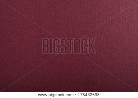 wine-colored paper texture for background. macro photo