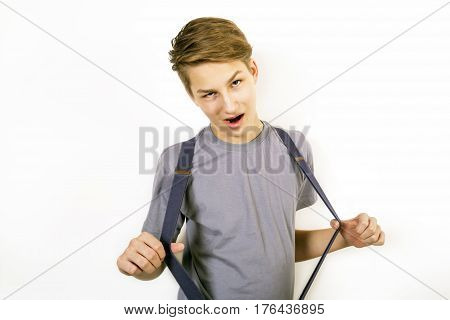Teenager in a gray shirt plays the fool
