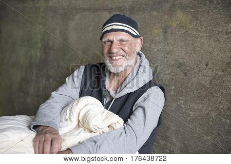 Portrait of a happy mature homeless man
