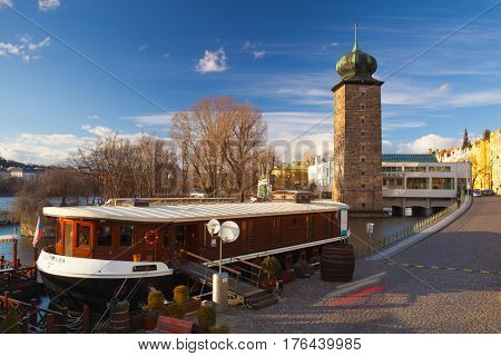 Prague Czech Republic - March 3 2017: Ristorante Botel Matylda on the Vltava river. This romantic dining spot is located on a boat in the river Vltava and serves Italian food with beautiful views of Prague Castle.