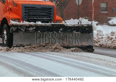 Residential Area Snowplow On The Road