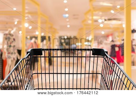 Shopping cart in blur shopping mall background