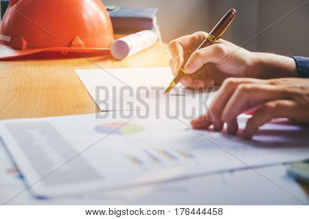 Architect Man Working With Laptop And Blueprints,engineer Inspection In Home Office For Architectura