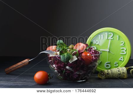 Fresh Salad In Glass Bowl With Tomato