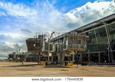 PHUKET THAILAND - 2015 Oct 20 : The Building aerobridge at Phuket International Airport on July 28 2012. Phuket Thailand.