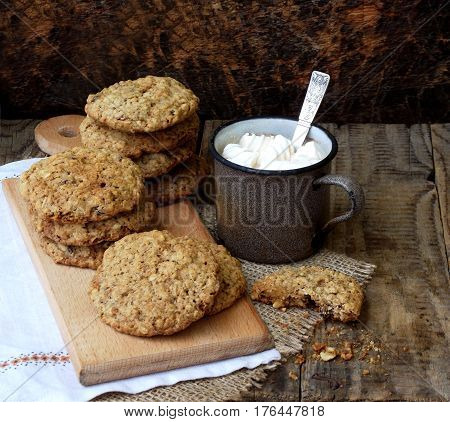Flourless Gluten Free Peanut Butter, Oatmeal, Dried Fruits Cookies And Cup Of Cocoa With Marshmallow