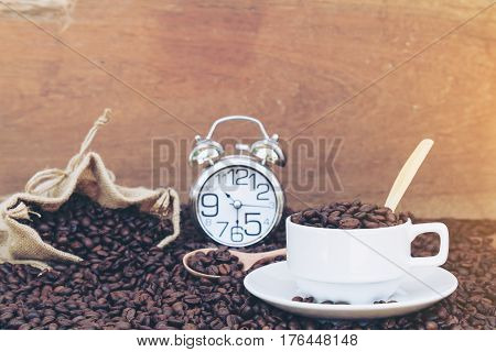 Concept Fall in love coffee and clock show time 10 22 am or pm and 30 minute on wood table and wooden background with copy space.