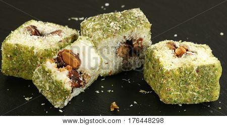coconut covered pistachio turkish delights on a slate