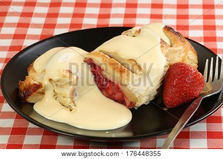 fresh summer fruit strudel with vanilla custard sauce