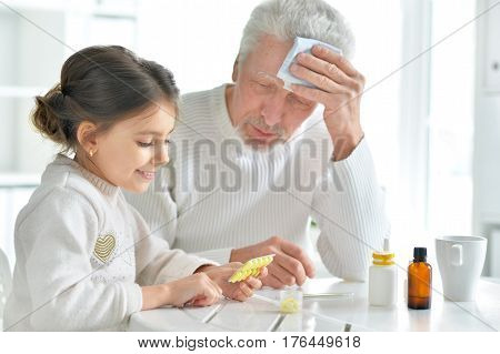 Portrait of the granddaughter takes care of a sick grandfather