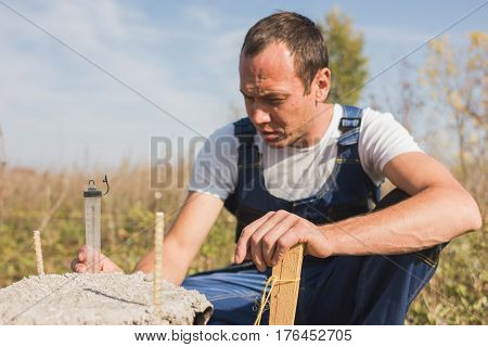 Worker builder in jumpsuit working outdoors, portrait, close up