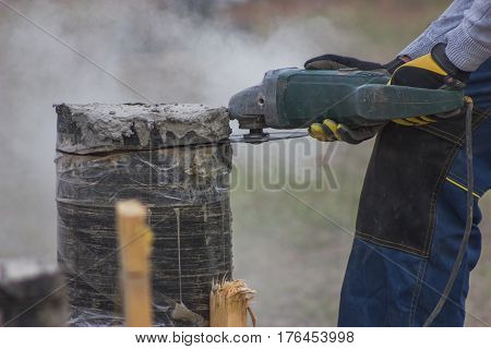 Close up view of working circular saw outdoors, sawdust flying around, telephoto shot