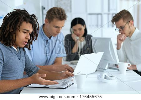 Portrait of a young businesspeople working in ofiice