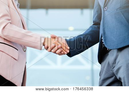 Successful Business Peolple Handshaking After Good Deal.